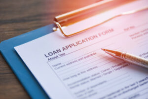 Loan application form with pen