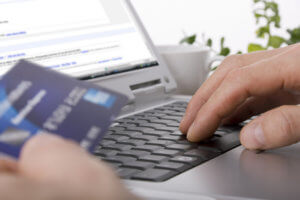 Online shopper typing in their credit card information