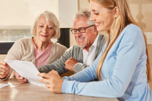 Daughter helps parents review documents for their retirement
