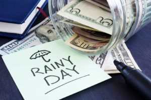 Money in a glass jar for a rainy day