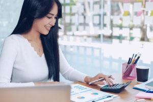 Female financial advisor using a calculator