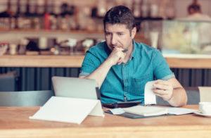 Restaurant owner reviewing bills