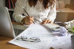 Accountant filing taxes at desk