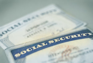 A closeup of two US social security cards