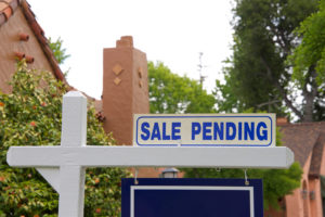 Close up of a pending sale sign for a house in escrow